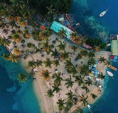 Marigot Bay is always drenched in golden sunshine. Here's a bird's eye view of La Bas beach. See you at @capellastlucia! Picture: @davidrobertellis1  #StLucia #summer #beach #sea #ocean #island #marigotbay #travel