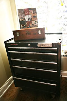 "A tool chest in place of a dresser, what a cool idea! This ""little man's vintage racingroom"" is a winner!"