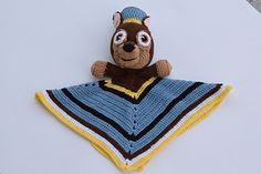 Crochet flying rescue puppy safety blanket . Made of soft cotton / acryl yarn in light blue, dark brown, dark cream and yellow colors . It has been made inspired by the famous kids cartoon Paw Patrol .