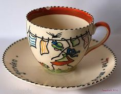 "Crown Ducal Nursery Cup & Saucer Charlotte Rhead's ""The Maid Was In The Garden"""