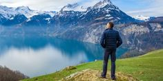A man looks at the reflection of snow-capped mountains on a lake Jehovah S Witnesses, Hope For The Future, Bible Teachings, Faith In God, Men Looks, Mountains, Travel, Reflection, Paradise