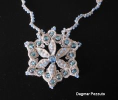 a tatted lace centerpiece with cluny leaves and beading by Dagmar Pezzuto