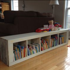 Upright bookshelf laid down; for kids book storage & play space on top!!