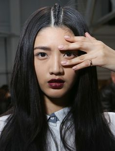 Jin Soon Choi applied two coats of Nostalgia ($18) as a base and then topped the nude with one coat of Polka White (available Spring 2014) for a speckled manicure. // she's gorgeous!