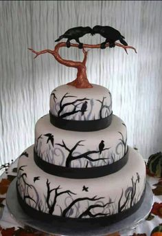 Poe cake.  Like the ravens but not the ribbons or the topper, needs an upgrade