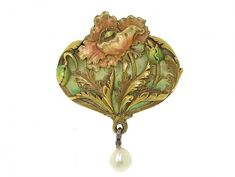 Art Nouveau brooch or pendant, 1900s  Featuring an elegant and elaborate floral motif, this antique pairs carefully crafted yellow gold with enamel - including an enchanting, transparent plique-a-jour backdrop - depicts a single pink-toned poppy...