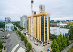 Acton Ostry Architects Complete World's tallest wood building in Vancouver Shanghai Tower, Forest Ecosystem, Wood Columns, Wooden Buildings, Concrete Structure, Timber Wood, Built Environment, World Trade Center, Civil Engineering