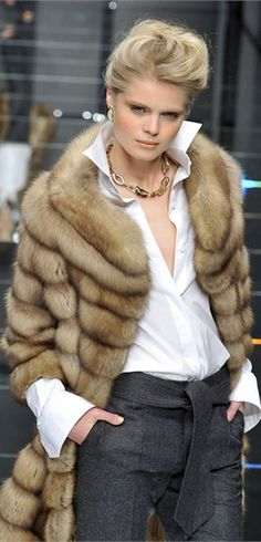 Carlo Tivioli. very nice look. I like the white shirt with the fur, opposites but they go together.