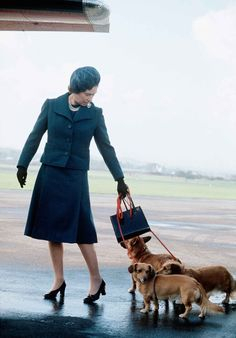 1974 Queen Elizabeth arrives at Aberdeen Airport with her corgis to start her holiday in Balmoral, Scotland.