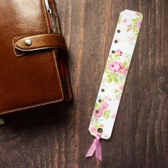 A5 filofax ribbon page marker on Etsy, $3.43 AUD - nice, but you can do the same thing with your favorite bookmark and a single hole punch.