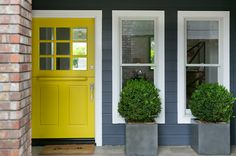 Incorporate bright colors throughout your home in the winter. Warm welcome yellow front door #TheHurstTeam #Houzz