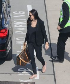 Angelina Jolie Pitt in Chloé - The nude ballet skimmer sported by Jolie Pitt caused a sensation this summer for its chic, effortless solution to the conundrum of airport dressing.