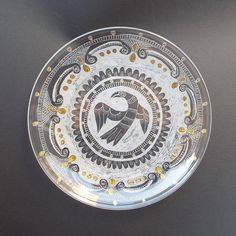 """Hand engraved on glass Dish/Dish with magic bird/ Wedding housewarming gift/ Living room ideas/Collectible glass/New home gift/Couple gift      This is one beautiful glass dish. It is hand-engraved with a stylish design with one bird in the center.    This decorative dish looks beautiful in the centre of any table.    Measurements of the dish: 9.1"""" / 23 cm / diameter    ----------------------------------------------------------------------------    All of my glassware is individually hand…"""