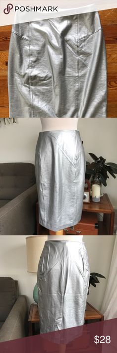 """Lysse Vegan Faux Leather Pencil Skirt Silver High-waist faux leather pull-on skirt from Lysse in metallic silver. Nice side panels and seam details at hips. Fits size 4-6. High-waist control and soft stretch lining with elasticized waistband. Great condition. 25"""" long.  Fast shipping from a smoke-free, pet-friendly home. Lysse Skirts Pencil"""