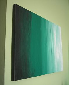 "Shades of green blend together to create this striking work of art. A dark, almost black, green fades to a pale, minty shade.  I've used a mixture of acrylic paints, on a canvas measuring 40cm (15.8"") wide by 30cm (11.8"") high, to create this piece. The colours of these paints continue over the sides of the canvas on which this is painted, to give one continuous block of colour, meaning that this painting does not need to be framed."