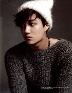 out of all the pictures i saw in the  magazine... i like this one the best because of his skin and the hat, the sweater, and the way he i looking idky but this picture stood out to me the most
