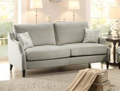 Banburry Collection Sofa 8479-3 for $525 The smaller scale of the Banburry Collection lends to stylish urban living. Reversible feather and polyester blend seat, and back cushions are encased in a modern graphite grey covering with contrast toss pillows. Nail head accent and long profile legs further enhance the modern design. Features:  High resilient foam Reversible seat cushions and back cushions Banburry Collection Traditional Style Transitional Style Graphite grey Color 100% Polyester…