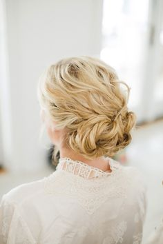 Wavy updo for a beach wedding | Amy Campbell http://southernweddings.com/2016/06/23/alys-beach-wedding-amy-campbell/