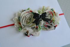 Shabby Flowers with Black Sequin Bow Embelishment