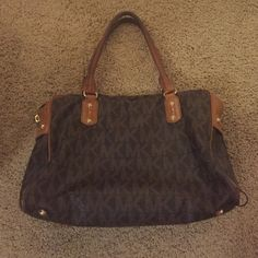 Authentic Loved Michael Kors Bag Well loved Michael Kors bag...looking for a new home! Worn handles and pictures of damage on bottom corner. Michael Kors Bags Shoulder Bags