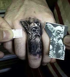 finger tattoo of odin