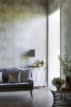 Elegant wallpaper featuring an all over, delicate large scale feather wallpaper design.