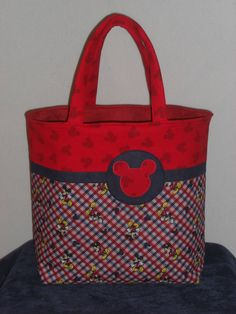 Mickey Mouse! This bag has pockets for magazines/color books and a box of colors. It is made for a toy/activity bag, but it can be used for other things as well. Cost is $55. For order details visit my facebook page http://www.facebook.com/HandmadebyJB