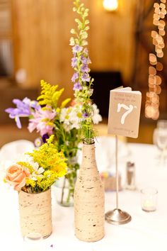 Table numbers doubled as guest books for guests to sign as a note for an anniversary. | Kristen Dee Photography