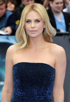 An easygoing medium-length style on Charlize Theron