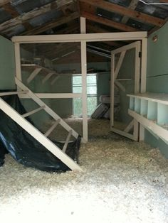 Our barn loft chicken coop conversion with a poop hammock.