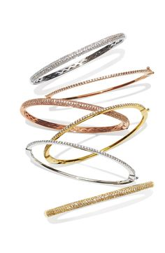 Love these glitzy gold, rose gold, and silver bangles. Will take one of every color, please!