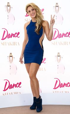 Shakira from The Big Picture: Today's Hot Pics  Peace! The latin singer is flawless in a blue cut out dress in Brazil.