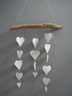 DIY happening. Ceramic hearts or stars or circles, who cares. Driftwood. Perfect!