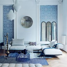 Beautiful living room with Persian wallpaper and modern seating