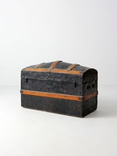 circa mid 1800s Beautifully aged, this is an antique metal-covered trunk. It features a domed top with wood staves and brass fixtures. The lock closures are partially intact for display. The interior