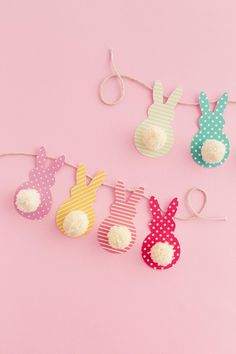This colorful Easter garland is so easy to make with scrapbook paper and yarn! Both kids and adults will love making this together. via diy kids Pom Pom Bunny Tail Easter Garland in a Few Steps - DIY Candy Easter Crafts For Adults, Kids Crafts, Baby Crafts To Make, Easter Craft Activities, Easter Arts And Crafts, Baby Activities, Creative Crafts, Preschool Crafts, Spring Crafts
