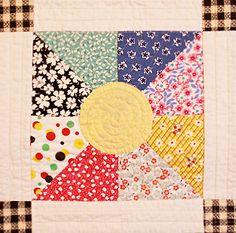 Summer Days quilt detail HST with circle applique.
