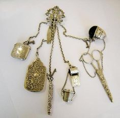 Victorian silver chatelaine, Birmingham 1889, ( includes a propelling pencil, notebook, vesta case, pin cushion, scissors in scabbard, thimble case and thimble and a tape holder.)