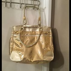 """Purse⭐️⭐️ Gold purse with light blue soft lining. Purse has big inside pocket, inside zipper pocket, cell phone pocket, key clip, 2 pen holders and an outside pocket.  Width 15"""", length 13"""", depth 10"""" and hand length 9"""".  Genuine leather trim.  Super nice bag for that special weekend!  Gold shoes to match also in my closet bundle and save 15%!! Carlos Falchi Bags"""
