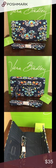 """NWT VERA BRADLEY STRAP WALLET CROSSBODY Brand new and authentic  Vera BRADLEY chandelier floral  Size: 7.5"""" W x 4.75"""" H with 54"""" strap drop  Details  ·        Trifold design with magnetic snap closure ·        Two different size gusseted zip pockets outside back ·        12 card slots, 3 bill pockets and one ID window inside ·      One 54"""" removable strap included  Smoke/pet free home Vera Bradley Bags Wallets"""
