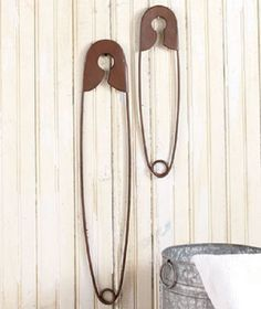 Laundry Room Wall Decor has a nostalgic style that fits in any home. The Set of 2 Safety Pins is a cute addition to any country decorating plan. Rustic bronze finish gives the metal pins an antique lo