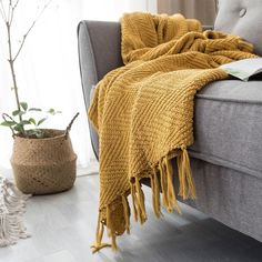 Knit from the finest materials, the blanket is an elegant neutral with beautiful color and design that is sure to be an amazing accent to any bed or living space. Mustard Yellow Blanket Sofa Knit Throw Blanket #homedecor #sofa #blankets