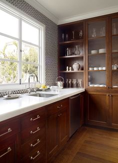 Wood cabinets with cool knobs and great counters. Nice mix of woods, too.