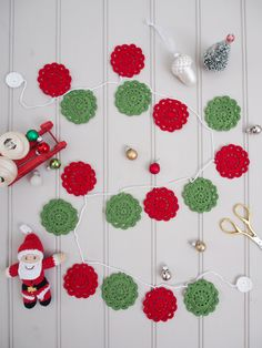 Japanese Christmas Garland by Messy LA Crochet Christmas Garland, Crochet Garland, Christmas Bunting, Christmas Crochet Patterns, Holiday Crochet, Crochet Toys Patterns, Crochet Motif, Crochet Crafts, Crochet Flowers