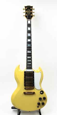 "CLEAN, limited run Gibson SG Pre-Historic reissue. Three humbucking pickups, all original gold hardware. Saddle on the high ""E"" string has been replaced. Antique ivory has aged into a mature yellow, and some mild checking is present throughout. Block iinlays, ebony fretboard, bound-headstock. 24 3/4"" scale, original molded Gibson case included."