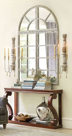 Gorgeous entryway with a Grand Chateau Window Mirror and large scones