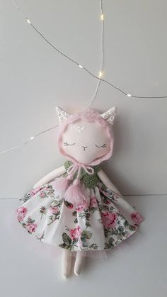 Little Kitty cloth doll made with lots of love and care. This doll is: - handmade from cotton fabric - 16 (41cm) tall from ears to toes. - filled with hypoallergenic poly fiber - hand embroidered face - comes with removable clothes: dress, mohair cardigan, crocheted bonnet hat. Only