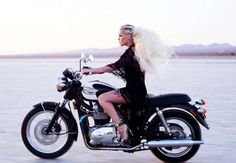 Pink is showing how it is done. Heels on a motorcycle.