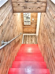 Luxury rental farmhouse vacation cabin on the Caddo River in Glenwood, AR, red stairs