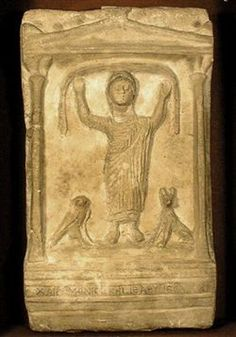 A Romano-Egyptian stella depicting the deceased Chairemonis, with his arms raised in worship; the falcon and jackal represent the gods Horus and Anubis. (KMKG – MRAH, Brussels, Belgium, via www.globalegyptianmuseum.org)
